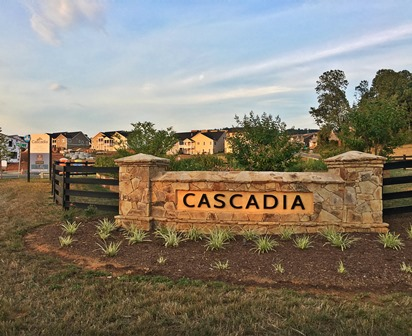 Cascadia community sign with homes in the background.