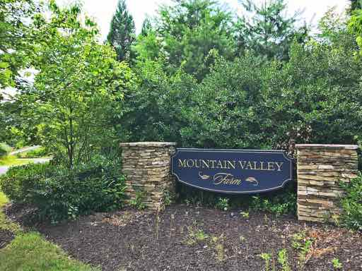 Mountain valley farm signage leading into subdivision
